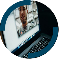 Image of person appearing by video conference on a laptop